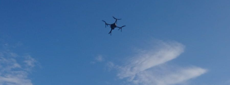 picture of drone flying over field